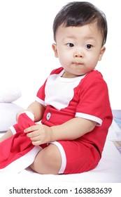 Baby boy with Santa concept in studio