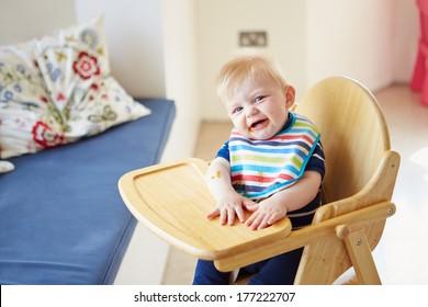 Baby Boy Sitting In High Chair