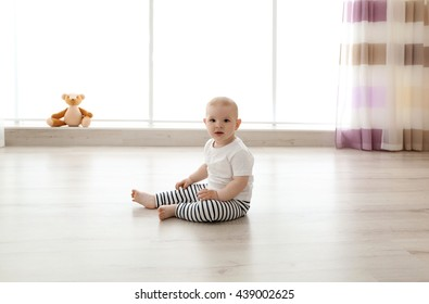 Baby boy sitting in the room