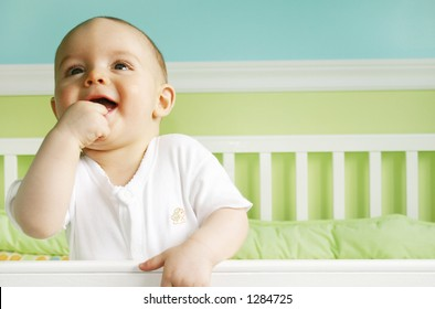 Baby Boy Smiling in crib