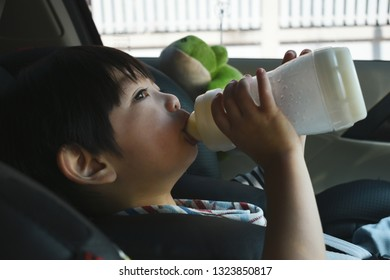Cute boys sucking in a car