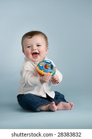 baby boy with toy