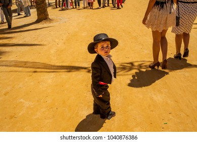 Baby boy with typical spanish regional costume. Seville. Spain