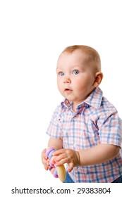 Baby boy wearing shirt holding toy isolated on white