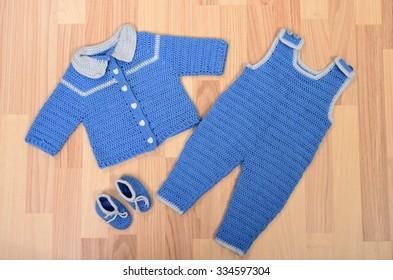 802c485b6 Baby Clothes Lying On Floor Winter Stock Photo (Edit Now) 334597298 ...