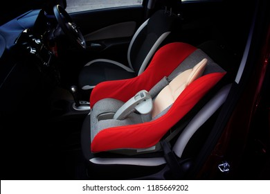 Baby car seat installed on a passenger seat in a car, automotive part concept.