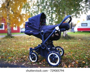 Baby carriage in colorful autumn