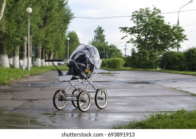 Baby carriage on an empty street
