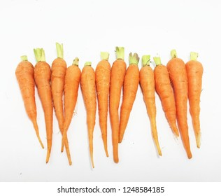 Baby carrot on white background.Carrots (carrots) help nourish the eyes. Because carrots have beta carotene. One of the vitamins that the body needs.