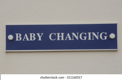 """""""Baby Changing"""" Sign on Woolacombe Beach, on the North Coast of Devon, England, UK"""