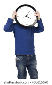 Baby, child boy in blue jacket and jeans standing on white background and holding large clock. Isolated, Mock up, branding, Unhappy, sad.