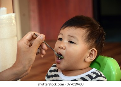 baby child eating in chair, thai baby