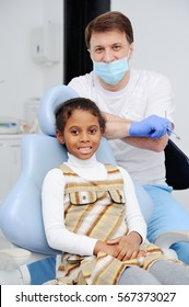baby and children's dentist patient smiling at the camera