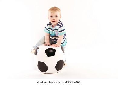 baby clambers on soccer ball