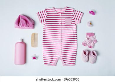 Baby clothes and accessories on white background