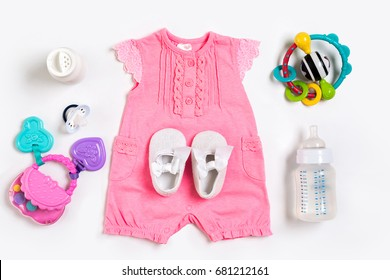 Baby clothes and accessories on white background. Top view