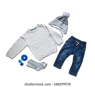 Baby clothes, concept of child fashion. Flat lay children's clothing and accessories. Baby template background with copy space. Top view fashion trendy look of baby clothes and toy stuff.