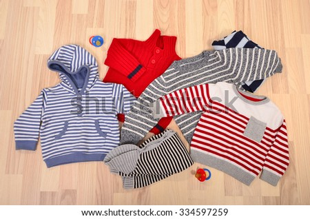 72b544535 Baby Clothes Lying On Floor Winter Stock Photo (Edit Now) 334597259 ...