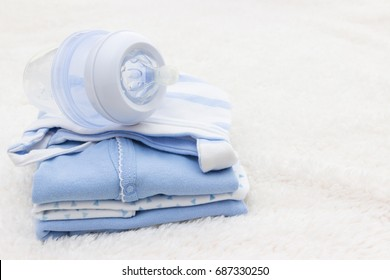 Baby clothes for newborn and pacifier , In blue colors.