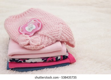 Baby clothes for newborn. In pink colors.