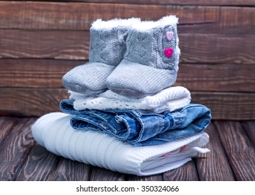 baby clothes on a table