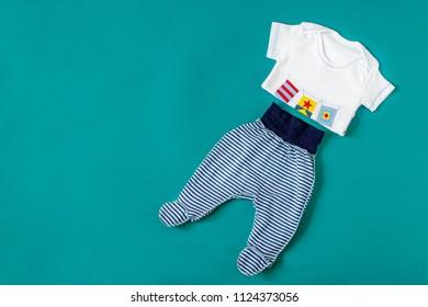 Baby Clothing. Flat lay. Concept of newborns, motherhood, care, lifestyle.
