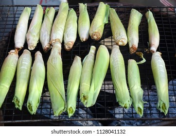 Baby corns are cooked on a charcoal grill