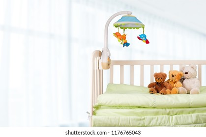 Baby cot with toys on bed
