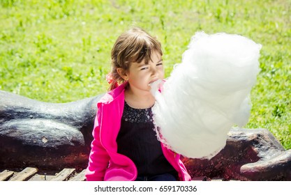 Baby and cotton candy. Selective focus.