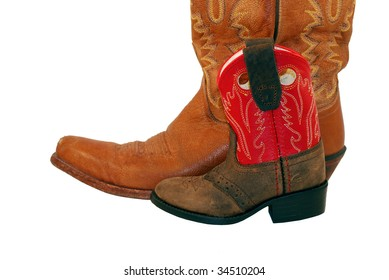 Baby cowgirl boot next to big cowgirl boot