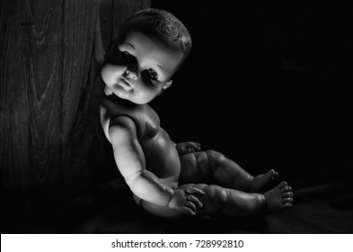 baby creepy doll alone in the dark in high contrast contrast concept