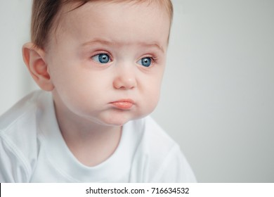The baby cries and calls mum from a bed