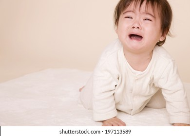 Baby With A Crying Face