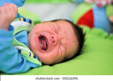 Baby is crying. Baby screaming because her stomach hurts. Screaming baby.