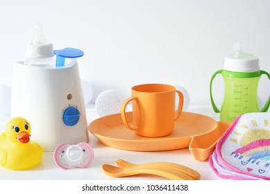 Baby dishes on the white table