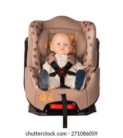 Baby doll fastened in a booster seat for car on white background
