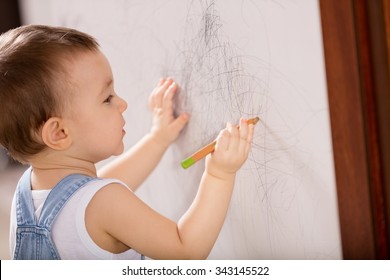 Baby drawing on wall.