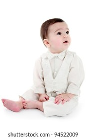 Baby dressed in Christening outfit