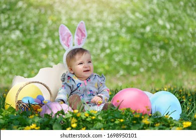 Baby in Easter decorations looking to the copy space area