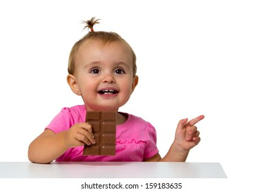 baby eating chocolate isolated on white
