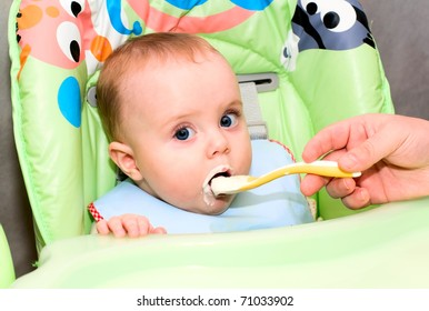 baby eating cottage cheese