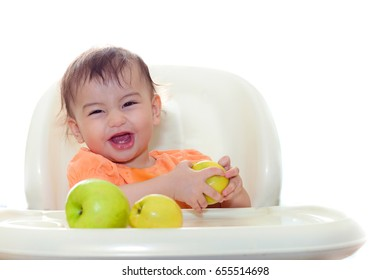 baby eating fresh fruits sit on the table