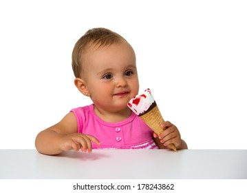 baby eating ice cream isolated on white