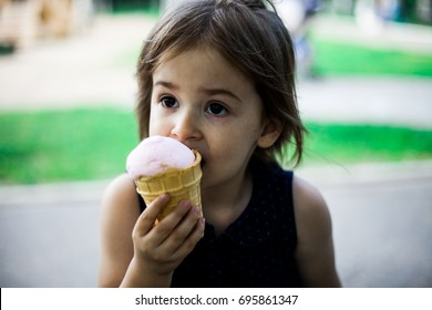 Baby eating ice-cream in a park