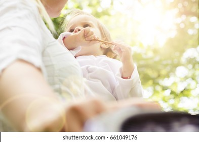 baby eating and walk around with mother in nature