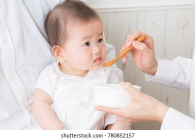A baby eats a baby food