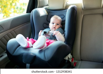 Baby enjoying the road trip in her cozy car seat