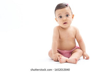 baby expressing surprise, in a studio on a white background