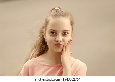 Baby face. Adorable baby face look. Little child with cute face. Small girl with healthy young face skin and long blond hair.