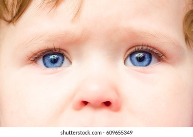 Baby face with blue eyes, close-up.